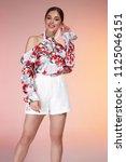 beautiful young sexy brunette... | Shutterstock . vector #1125046151