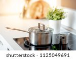 stainless steel pot on electric ... | Shutterstock . vector #1125049691