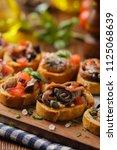 mix bruschetta with sardines... | Shutterstock . vector #1125068639