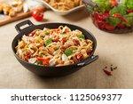 whole grain tagliatelle pasta... | Shutterstock . vector #1125069377