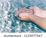 hands in water | Shutterstock . vector #1125077567