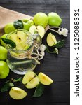 a glass jar of fresh water with ... | Shutterstock . vector #1125088331