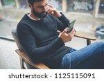 cheerful hispanic bearded man... | Shutterstock . vector #1125115091