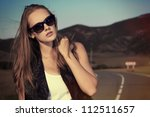 beautiful young woman posing on ... | Shutterstock . vector #112511657