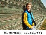 autumn outdoor portrait of a... | Shutterstock . vector #1125117551
