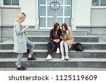 school girls sitting on the... | Shutterstock . vector #1125119609