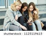 school girls using tablet... | Shutterstock . vector #1125119615
