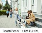 school girls sitting on the... | Shutterstock . vector #1125119621