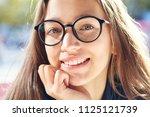 closeup portrait of a stylish... | Shutterstock . vector #1125121739