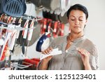 shopping in supermarket. woman... | Shutterstock . vector #1125123401