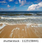 blue sea with small waves... | Shutterstock . vector #1125158441