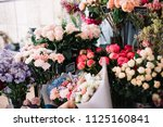 fresh flowers at the florist... | Shutterstock . vector #1125160841