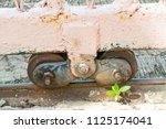 old slide door with wheel... | Shutterstock . vector #1125174041