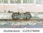 old slide door with wheel... | Shutterstock . vector #1125174044