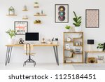 real photo of a desk with a... | Shutterstock . vector #1125184451