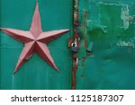 green metal gate with red... | Shutterstock . vector #1125187307