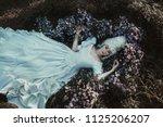 beautiful girl is posing in a... | Shutterstock . vector #1125206207