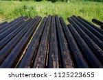 oil drill pipe. rusty drill... | Shutterstock . vector #1125223655
