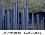 oil drill pipe. rusty drill... | Shutterstock . vector #1125223661
