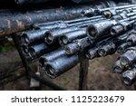 oil drill pipe. rusty drill... | Shutterstock . vector #1125223679