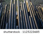 oil drill pipe. rusty drill... | Shutterstock . vector #1125223685