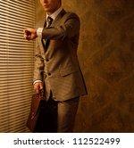 retro businessman looking at... | Shutterstock . vector #112522499