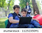 the father trains the son to... | Shutterstock . vector #1125235091