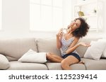smiling african american girl... | Shutterstock . vector #1125239414