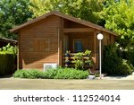 Wooden Bungalow And Garden