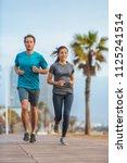 running couple runners friends... | Shutterstock . vector #1125241514