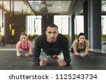 fitness group doing plank... | Shutterstock . vector #1125243734