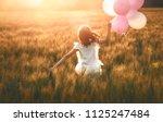 happy kid is having fun on... | Shutterstock . vector #1125247484