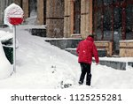 pedestrians walk in the snow... | Shutterstock . vector #1125255281