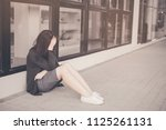 asian woman sitting alone and... | Shutterstock . vector #1125261131