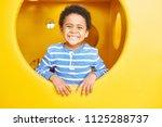 portrait of cute african... | Shutterstock . vector #1125288737