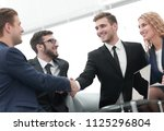 handshake of business people at ... | Shutterstock . vector #1125296804