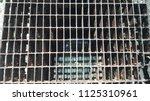 the old steel drain hose | Shutterstock . vector #1125310961