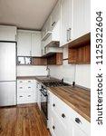 stylish light gray kitchen...   Shutterstock . vector #1125322604