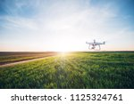 drone quad copter on green corn ... | Shutterstock . vector #1125324761
