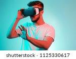 handsome bearded man trying vr... | Shutterstock . vector #1125330617