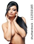 brunette woman with hands on breasts on white background - stock photo
