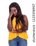 a worried young african woman ... | Shutterstock . vector #1125358907