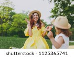 laughing woman in yellow... | Shutterstock . vector #1125365741
