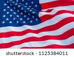 perfect american flag waving on ... | Shutterstock . vector #1125384011