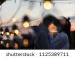 boy and girl hug each other... | Shutterstock . vector #1125389711