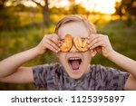 boy with cookies. cookies in... | Shutterstock . vector #1125395897