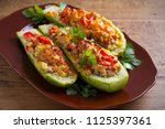 zucchini stuffed with meat ... | Shutterstock . vector #1125397361