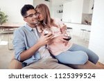 beautiful young couple with... | Shutterstock . vector #1125399524