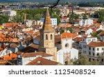 old town with spire of st. john ... | Shutterstock . vector #1125408524