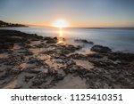 close up of waves rolling in... | Shutterstock . vector #1125410351